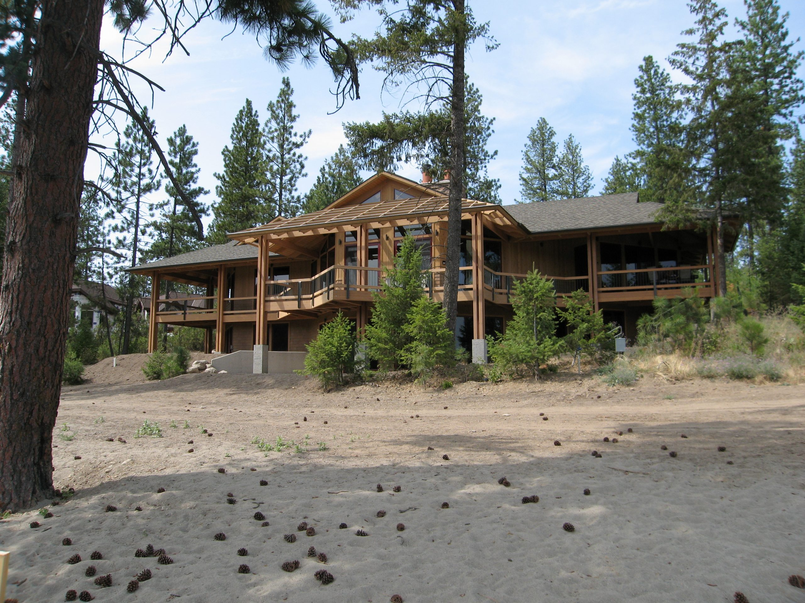 River residence is a custom home located in a beautiful waterfront setting on the Spokane River. The home features vaulted, wood-decked ceilings and a multitude of windows capturing the river views from almost every room.