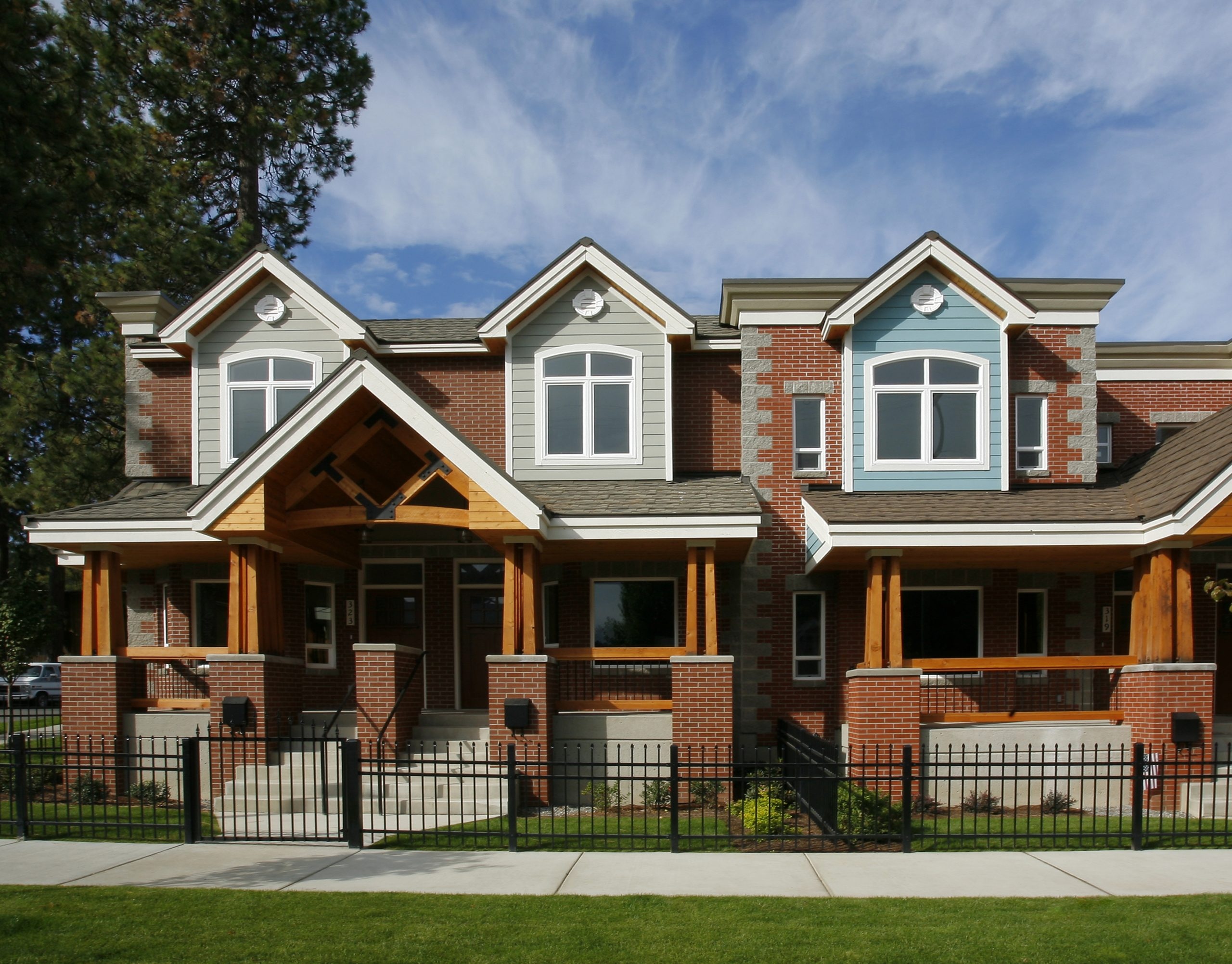 Ice Plant, located in downtown Coeur d'Alene, Idaho includes street front porches and tree lined streets to provide a sense of community and enhance the existing urban neighborhood fabric of the surrounding area.