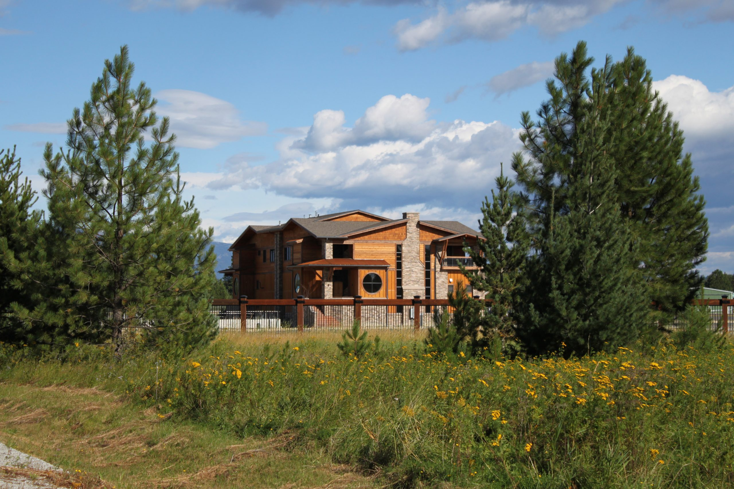Silverwing is a custom duplex located at the public airport in Sandpoint, Idaho. The building features natural materials, and Northwest architectural detailing, such as, exposed timbers and stained cedar siding.