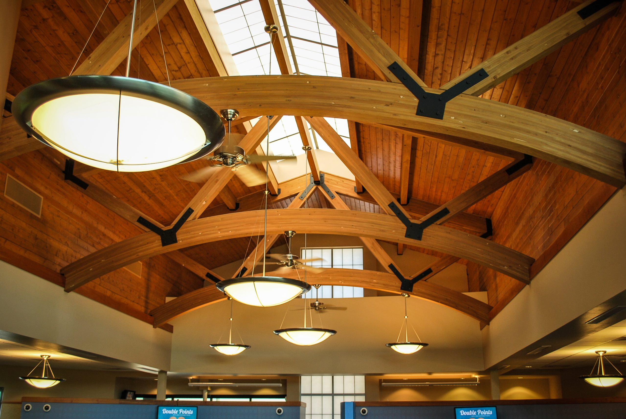 A new building for the Moses Lake, Washington branch of Horizon Credit Union the features an iconic tower element, exposed timber roof structure, and skylights.