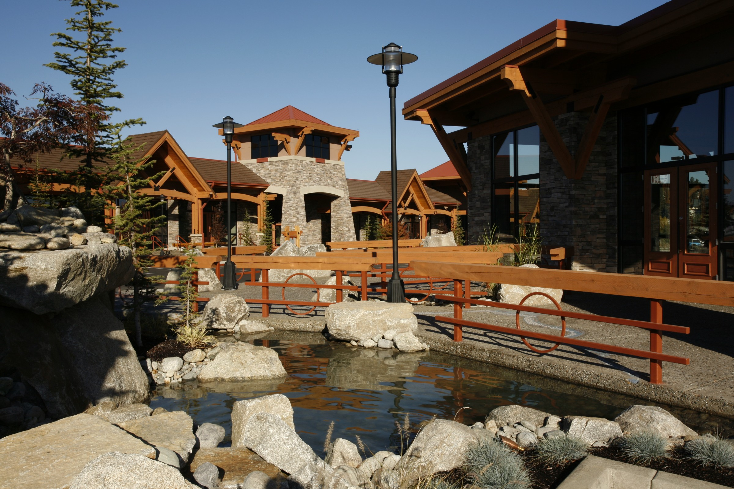 Hayden Creek Plaza is a multi-building retail shopping complex located in Hayden, Idaho that features the use of stone and wood timbers that compliment the regional vernacular.