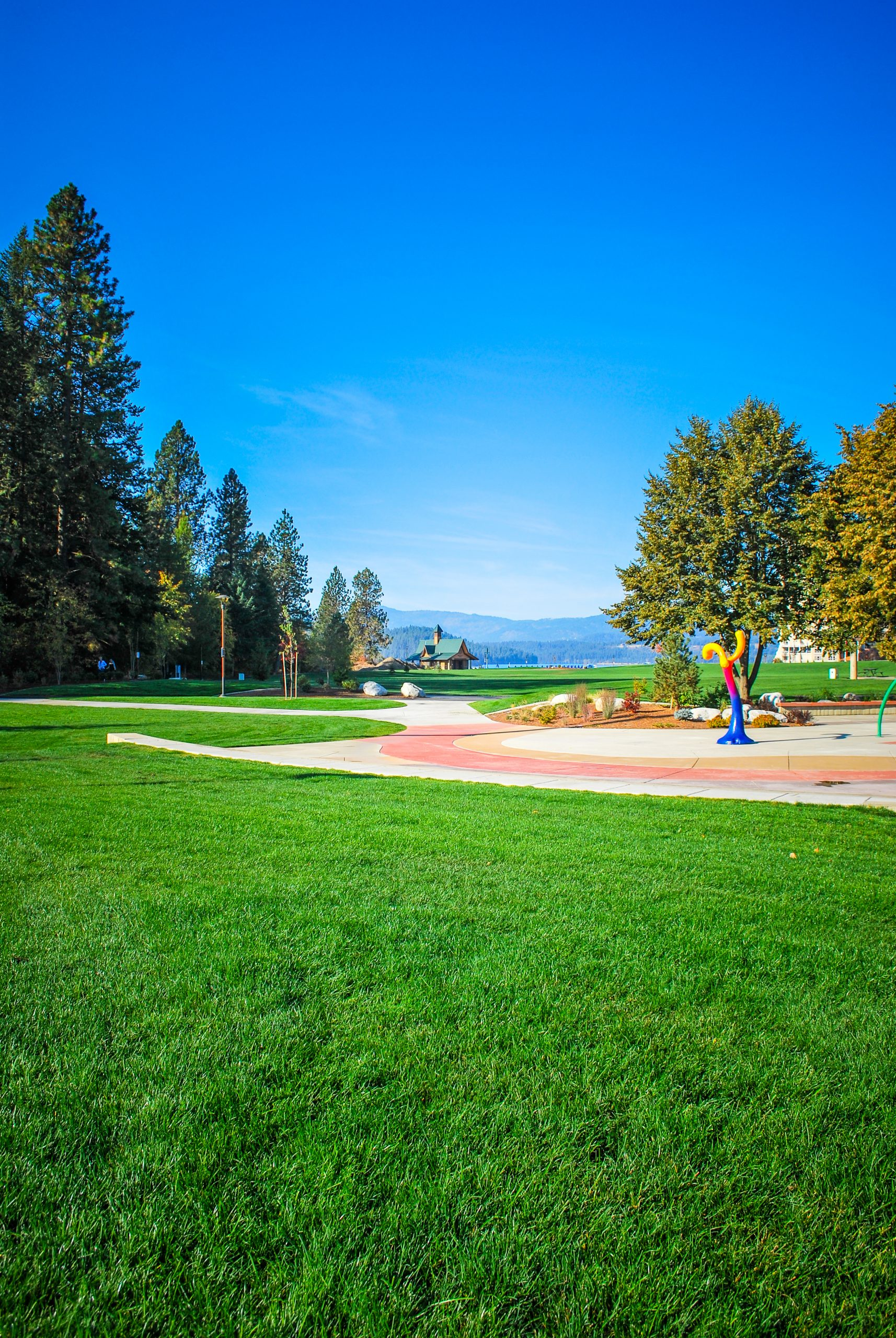 The McEuen Park Redevelopment was a collaborative project that features an ADA playground, splash pad, bike/pedestrian paths, open green space, grand pavillion, restrooms, dog park, subterranean parking structure, hardscape courts, lighting, and public art.